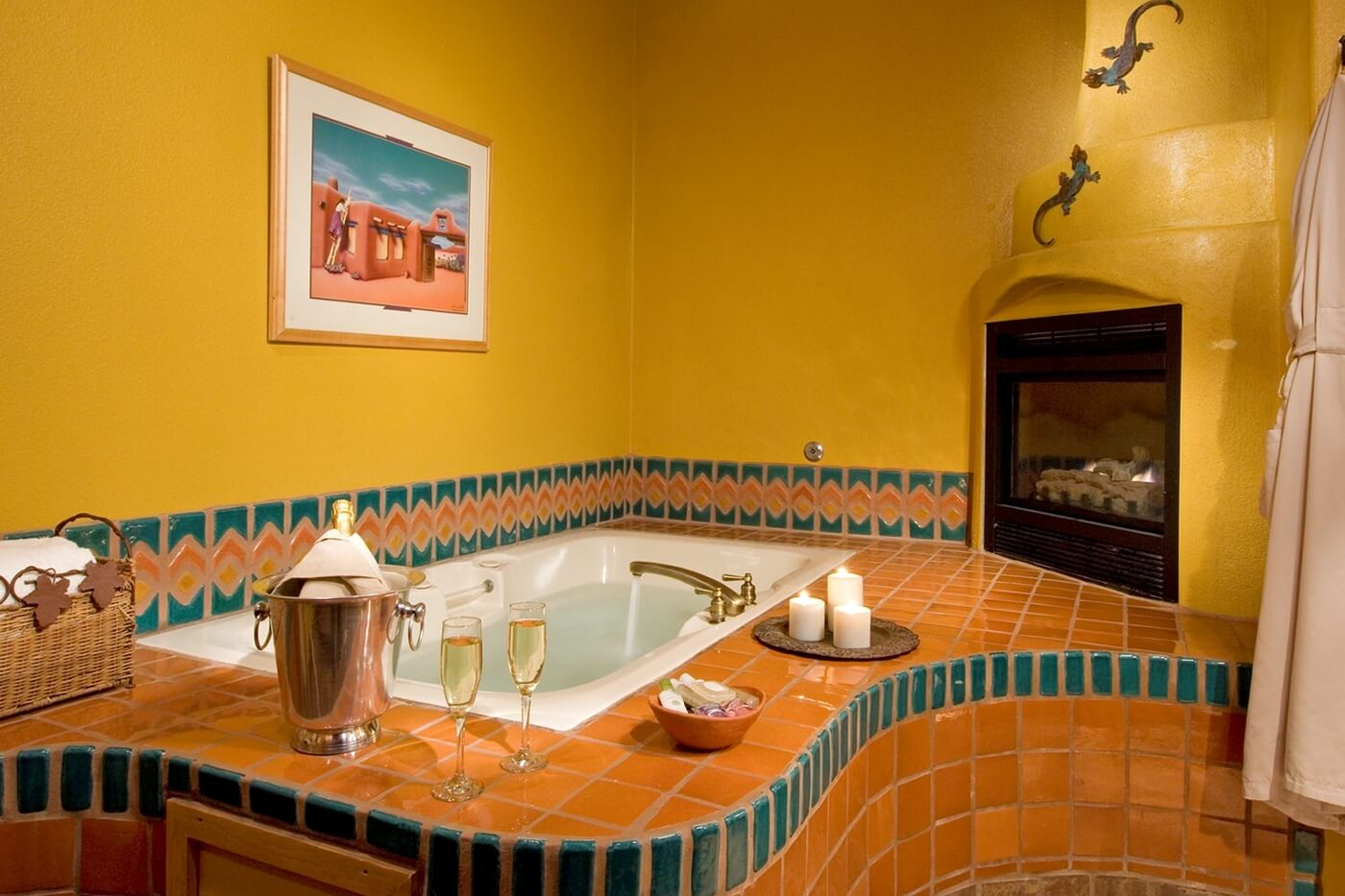 Oversized jetted bath tub with candle lit fireplace