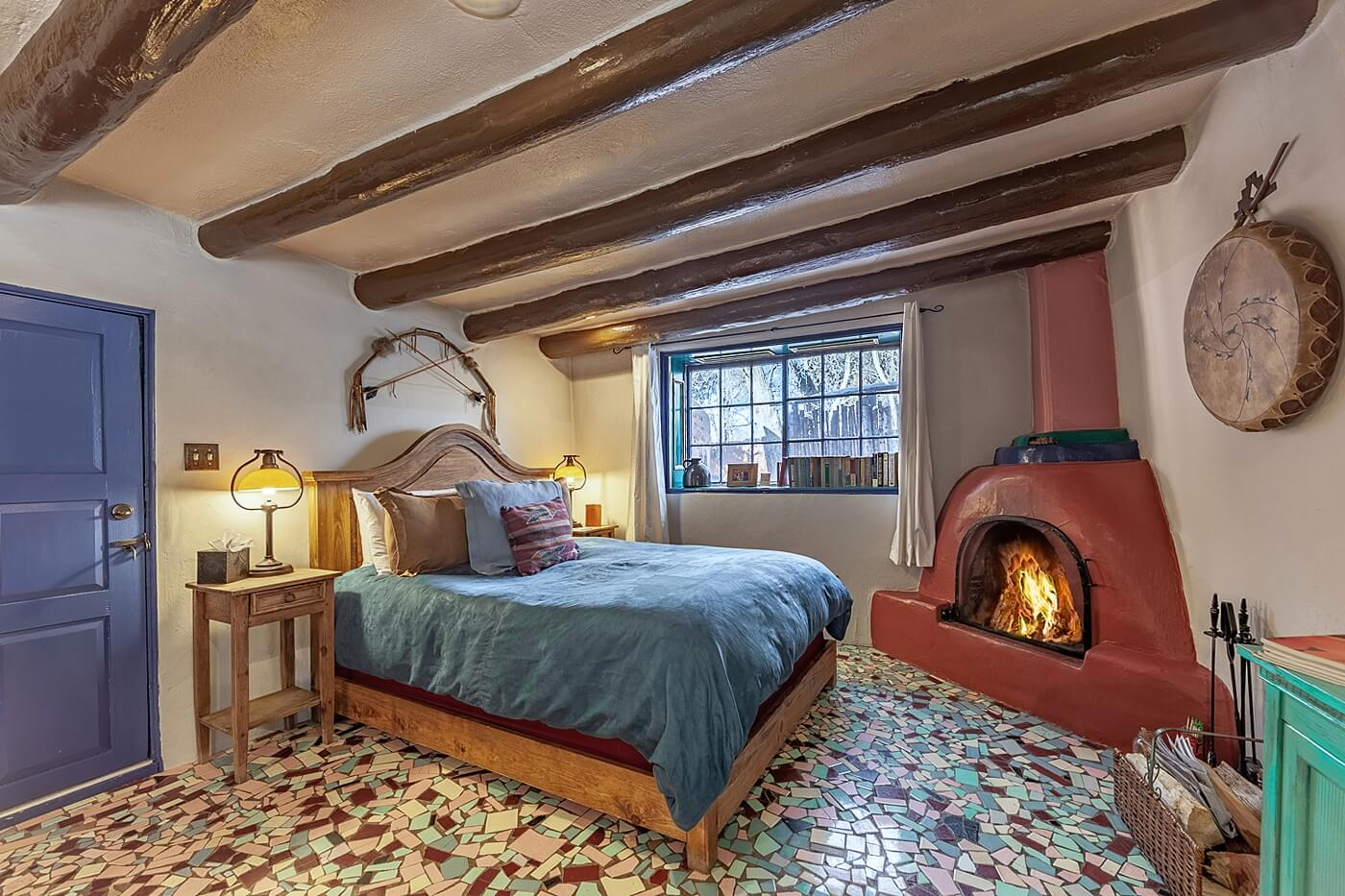 Bedroom with Wood burning fireplace